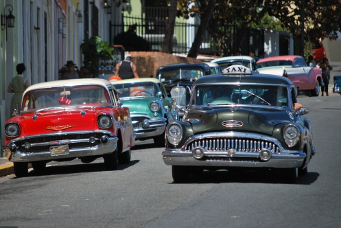 Johnny coming down the street filming Rum Diary in Puerto Rico